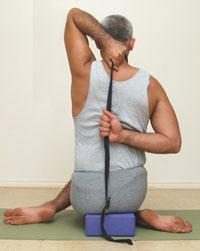 Yoga Pose Gomukhasana with strap